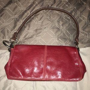 Super cute red purse.